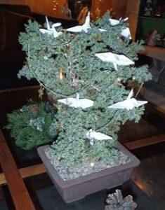 Paper cranes on bonai tree