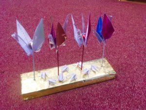 4 cranes on base: 1) Baby Angle Klein, 2) MoMath logo crane, 3) Poetry festival crane, 4) Thank you for a rabbi