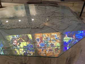 Chagall windows reflection on a table